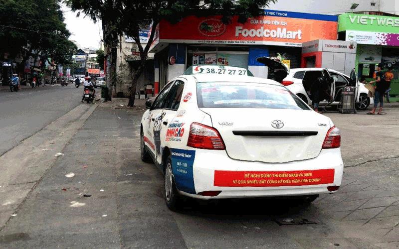 Yêu cầu Uber và Grab tuân thủ pháp luật Việt Nam
